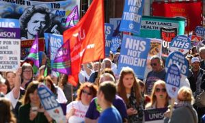 Protesters march through Manchester where the Conservative Party is holding its annual conference. Photograph: Dave Thompson/PA